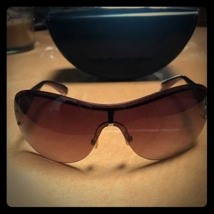 Maroon colored Marc Jacobs sunglasses with case
